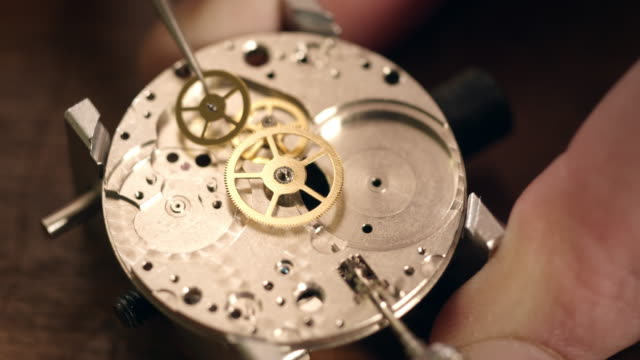 watchmaker assembling watch - watch timepiece stock videos and b-roll footage