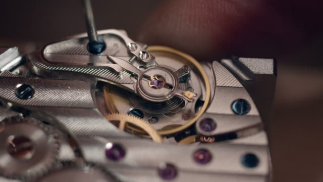 watchmaker assembling watch - clockworks stock videos & royalty-free footage