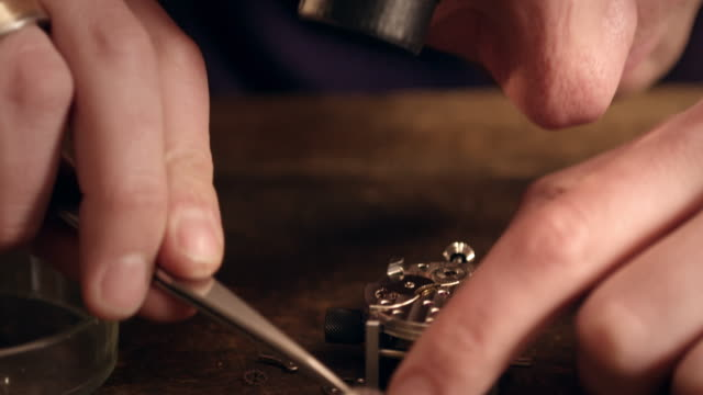 watchmaker assembling watch - part of stock videos & royalty-free footage