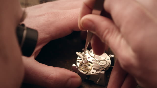 watchmaker assembling watch - adjusting stock videos & royalty-free footage