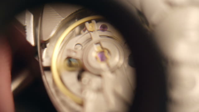 watchmaker assembling watch - instrument of time stock videos & royalty-free footage