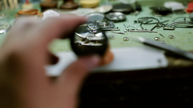 watchmaker looks through magnifying glass - antiquities stock videos & royalty-free footage