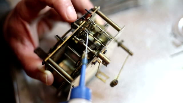 Watchmaker lubricates the engine hour