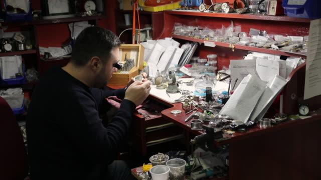 watchmaker repairing a vintage pocket watch - restoring stock videos & royalty-free footage