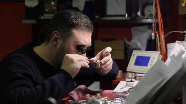 watchmaker repairing a vintage pocket watch - pocket watch stock videos & royalty-free footage