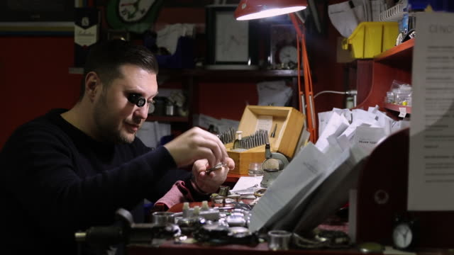 watchmaker repairing mechanical watch in his workshop - lens optical instrument stock videos & royalty-free footage