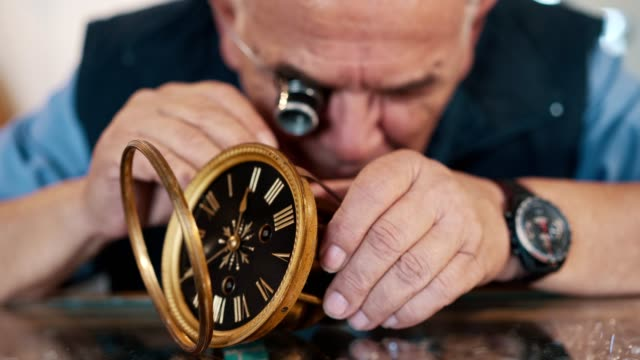 watchmaker repairing old clock - antique stock videos & royalty-free footage