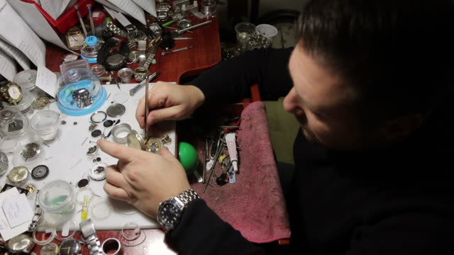 watchmaker repairing old fashioned pocket watch at his workshop - pocket watch stock videos & royalty-free footage