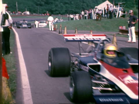 stockvideo's en b-roll-footage met watchtower showing that as of lap 32 jody scheckter brian redman and mark donohue are in the lead midohio sports car course / jody scheckter racing... - startvlag