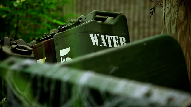 water 5 gallon tanks in the forest - medium group of objects stock videos and b-roll footage