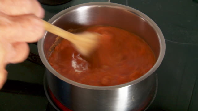 water added to tomato soup mix on stove top - tomato soup stock videos and b-roll footage