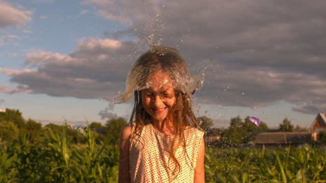water balloon splash - wet hair stock videos and b-roll footage