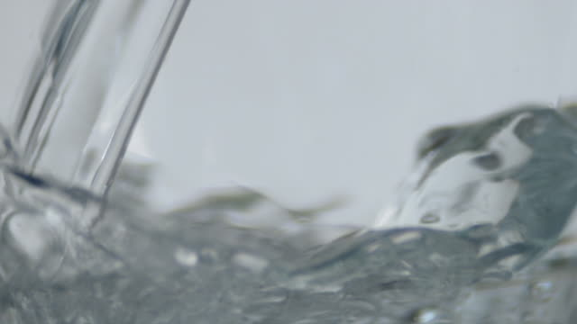 cu slo mo water being poured into glass / orem, utah, usa - グラス点の映像素材/bロール