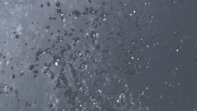 water bubbles and boils as geyser erupts. - quellwasser stock-videos und b-roll-filmmaterial