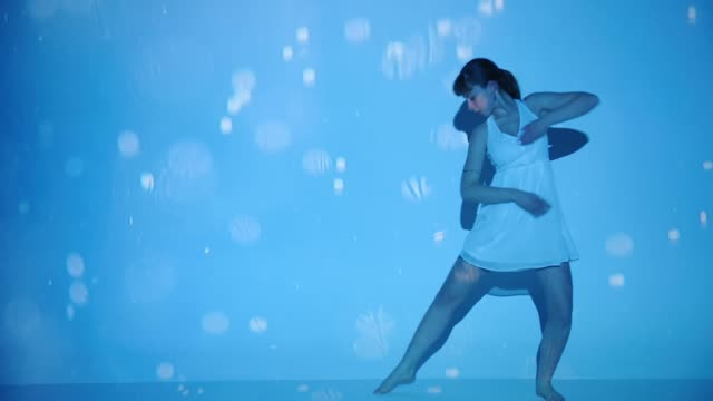 water bubbles projection upon a female dancer - coloured background stock videos & royalty-free footage