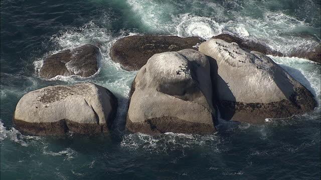 aerial water bubbling around rocks, cape of good hope, western cape, south africa - ケープ半島点の映像素材/bロール