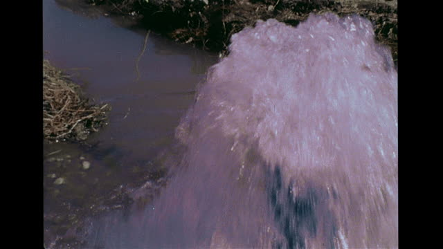 cu water bubbling streaming out of vertical pipe zo narrow creek in field vs scientist researcher testing ground water placing level sensor... - writing instrument stock videos & royalty-free footage