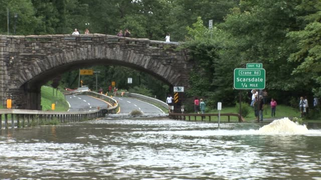 water bubbling up from ground on bronx river parkway at ardsley rd. overpass bronx river parkway flooded on august 28, 2011 in scarsdale, new york - hurricane irene stock videos & royalty-free footage