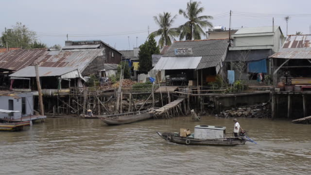 water canal in the mekong delta, vietnam - mekong delta stock videos & royalty-free footage