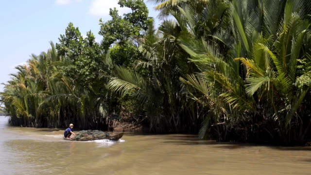 water canal on the mokong delta, vietnam - mekong delta stock videos & royalty-free footage