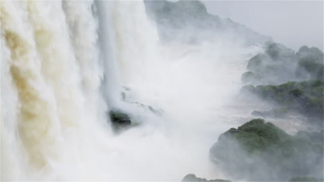 """ls water cascades onto rocks at the base of iguacu falls / foz do iguacu, brazil"" - cachoeira stock videos and b-roll footage"