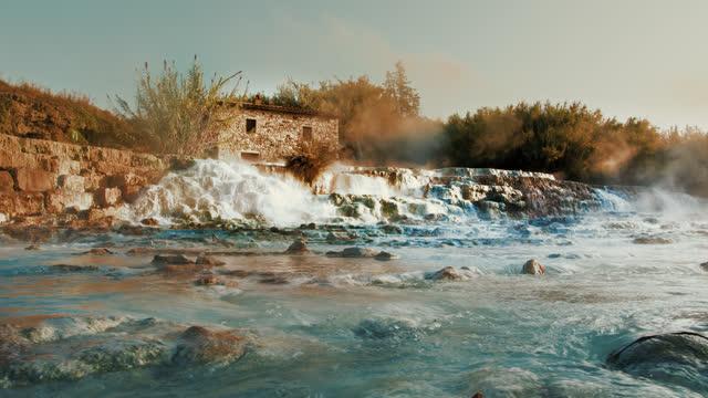 slo mo water cascading at famous landmark saturnia hot springs - natural landmark stock videos & royalty-free footage
