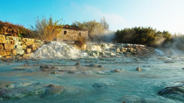 slo mo water cascading at the saturnia hot springs - natural landmark stock videos & royalty-free footage