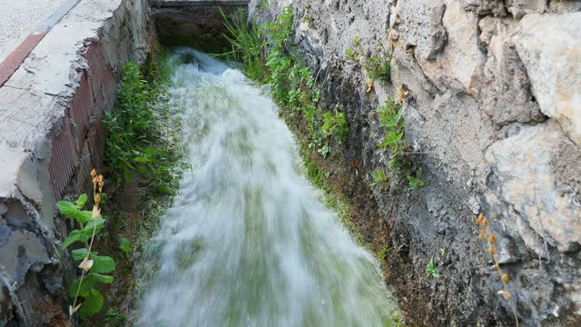 water circulating within an irrigation canal for an agricultural field. - flowing stock videos & royalty-free footage