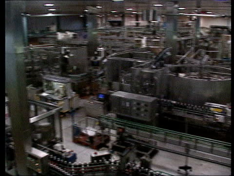 coca cola withdraws dasani brand after cancer scare; lib ???: tgv coca cola bottling plant - bottling plant stock videos & royalty-free footage