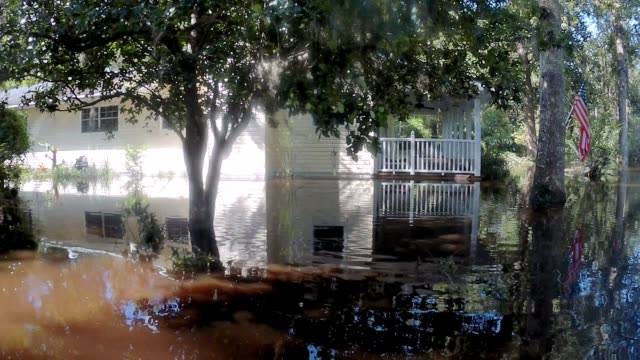 water comes up to 285foot near rooflines of homes near black creek in middleburg fl on september 12 2017 after water levels rose from hurricane irma... - florida us state stock videos and b-roll footage
