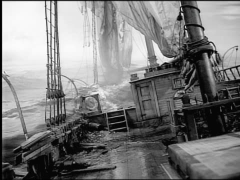 B/W water covering deck of sinking sailing ship (model) / camera on deck