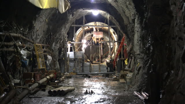 water covers the floor of a tunnel under construction in new york city. - equipment stock videos & royalty-free footage