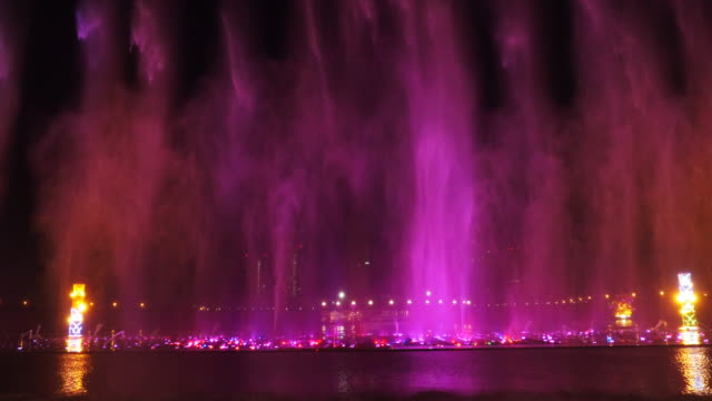 Water display feature in the centre of Ordos Inner Mongolia China Controlled water jets are lit in bright colours against the night sky