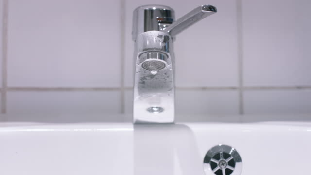 Water Dripping from Bathroom Sink Faucet