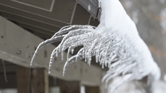 water dripping from curved, non-vertical icicles - water form stock videos and b-roll footage