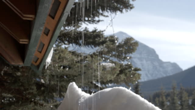 Water dripping from the roof of a chalet / Banff, Canada