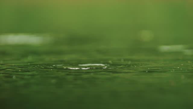 water drop falling on stream / eomjeong-myeon, chungju-si, chungcheongbuk-do, south korea - スーパースローモーション点の映像素材/bロール