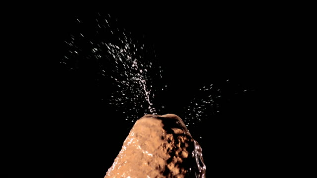 slo mo ld water drop falling onto stalagmite - stalagmite stock videos and b-roll footage