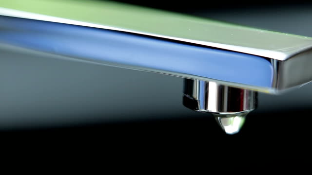 Water drop from the faucet.