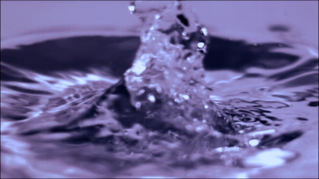 water drop in slow motion. shallow depth of field - splash crown stock videos and b-roll footage