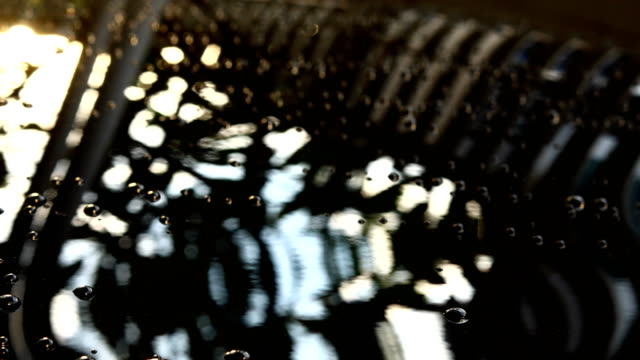 water drop on car with glass coating - saving up for a rainy day stock videos and b-roll footage