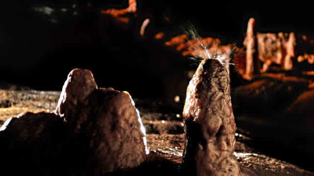 slo mo ld water drop shattering on stalagmite - stalagmite stock videos and b-roll footage