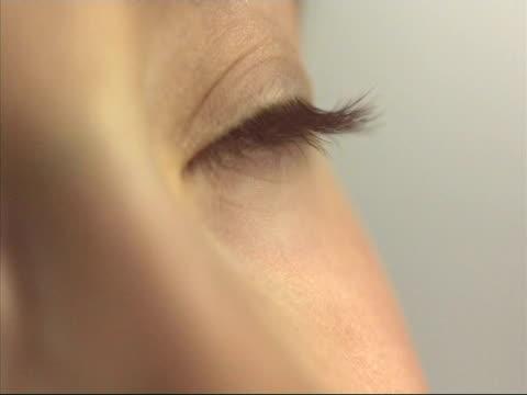 Water droplet falling on eyelash, high speed