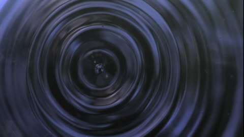 slomo water droplet falls into water, uk - water surface stock videos & royalty-free footage