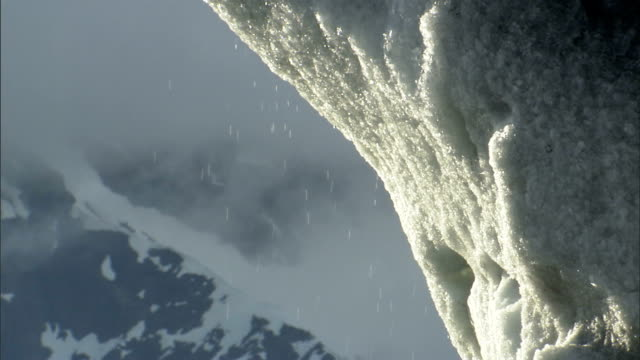 water droplets fall to the ground as a glacier melts. available in hd. - melting stock videos & royalty-free footage