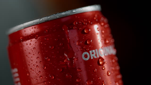 slo mo water droplets on the outside of a soda can - condensation stock videos and b-roll footage
