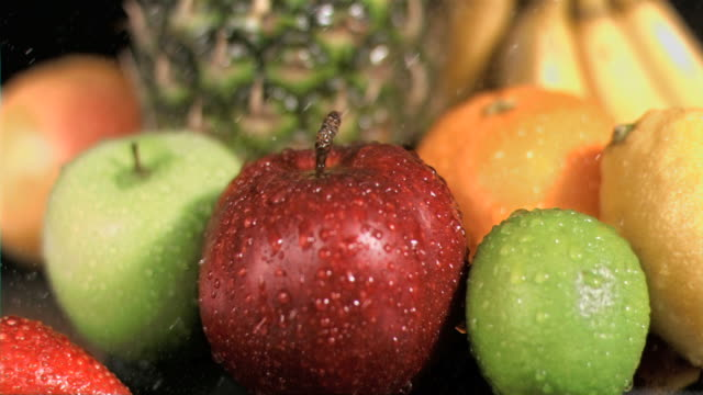 Water dropping on fruits in super slow motion