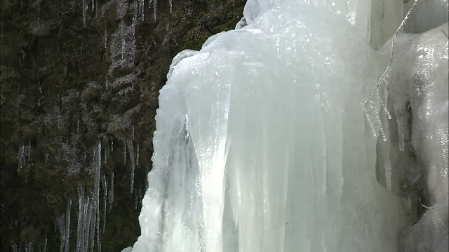 water drops on a sheet of ice on the fudo waterfall in japan. - frozen water stock videos & royalty-free footage