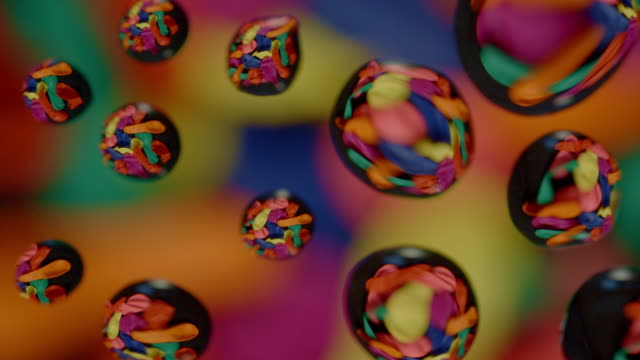 water drops on glass abstract background colored balloons rotating - water form stock videos and b-roll footage