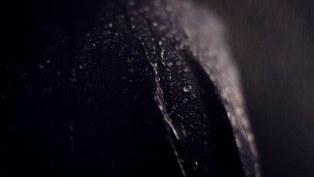 water drops on synthetic waterproof fabric. sports clothing close up - raincoat stock videos & royalty-free footage